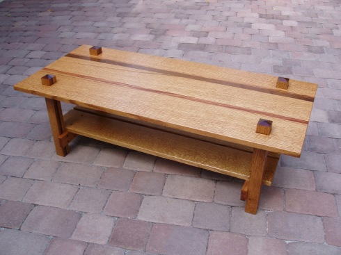 Occasional table in oak, mahogany or straightgrained walnut with moulded polywood top.