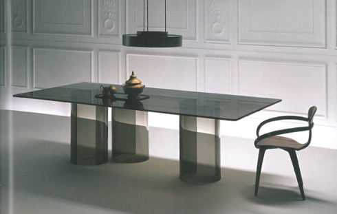 Luxor: Dining table with laminated smoked or bronze glass top, designed by Rodolpfo Dordoni.