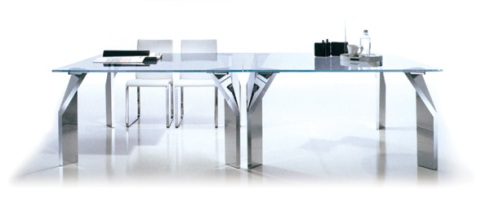 Twist: Table created to show the beauty of your room. Made up of chrome legs with top tempered glass.