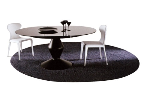 Loop: Extendible round dining table with a custom designed round carpet.