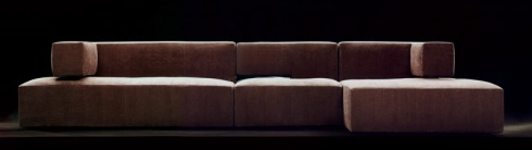 Tusca: Five seat sofa attached with a chaise longue in fabric, designed to provide extra comfort while resting.