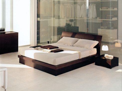Coil: Serene yet stylish double bed dark colored oak wood.