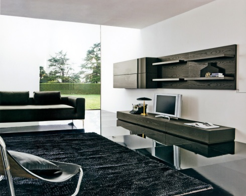 Garcia: Show the simplicity and modernity of your TV Room. Complete wall system in dark stained oak wood.